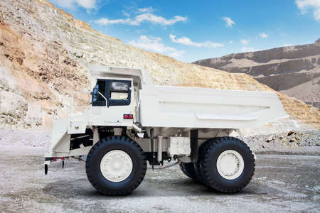 big body: Image of white mining truck with big body on the mining site Stock Photo
