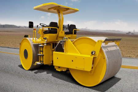 compacting: Image of a roller compactor machine compacting asphalt on the road construction