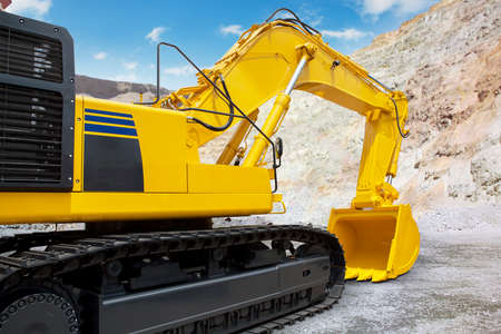 industrial machinery: Image of a new excavator with yellow color on the construction site, ready to work and excavation