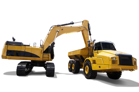 Image of heavy excavator with yellow color, loading soil on the truck. Isolated on white background