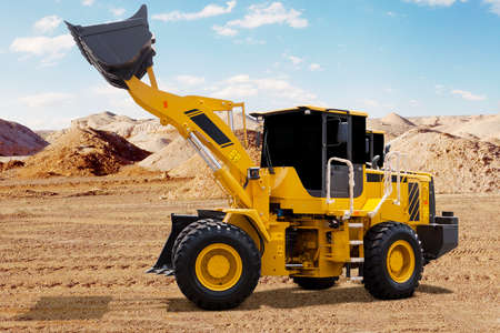 wheel loader: Big wheel loader with yellow color lifting the scoop on the mining site
