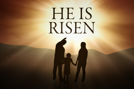 Silhouette of Christian family holding hands together while looking at text He is risen. Easter concept