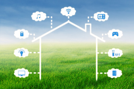grass field: Image of a design of smart home technology system on the field with green grass Stock Photo