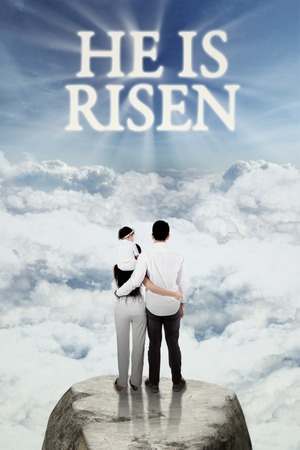 risen christ: Two parents and their daughter standing on the cliff while looking at text he is risen on the sky