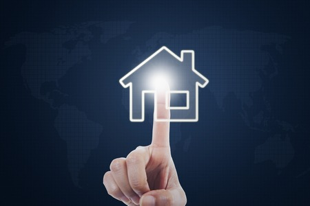 Image of female hand pressing a smart house button on the virtual screen