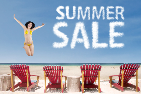 sexy asian girl: Summer sale clouds with sexy woman jumping over beach chairs