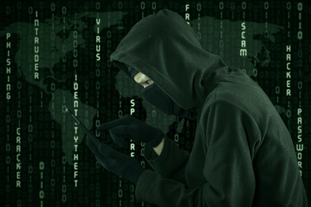 web scam: Hacker touching a smartphone screen with binary code background Stock Photo