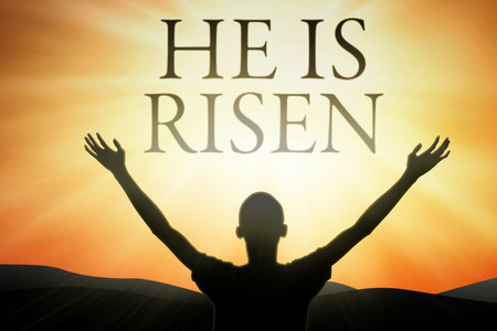 and he shines: Silhouette of male prayer raises hands with text He is risen Stock Photo