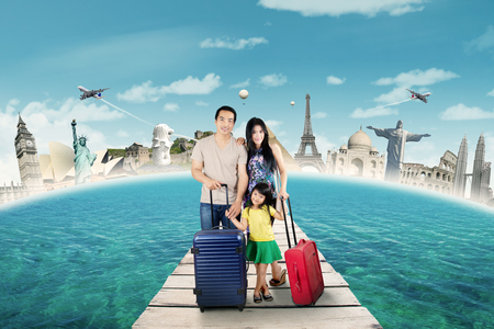 luggage travel: Group of happy family standing on the bridge with bags to holiday on the world monument Stock Photo