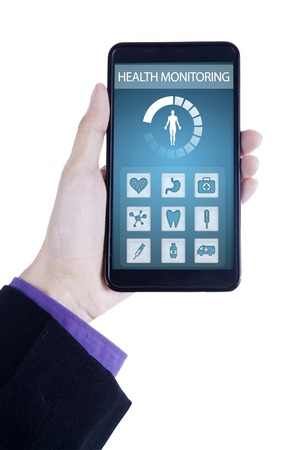 applications: Close up of hand holding a smartphone with health monitoring application on the screen
