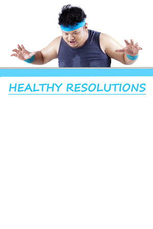 healthy looking: Photo of young obese person looking at the healthy resolution board with copy space