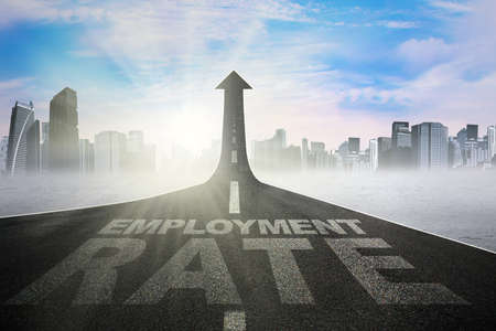employment: Image of employment rate text on the road shaped upward arrow, symbolizing growth of employment rate Stock Photo