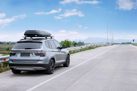 rack wheel: Picture of car parking on the roadside while carrying luggage rack for traveling