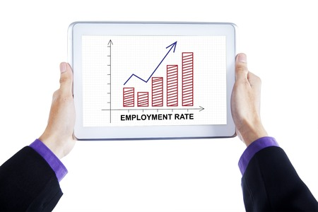 unemployment rate: Close up of businessman hands holding a digital tablet with employment rate chart on the screen