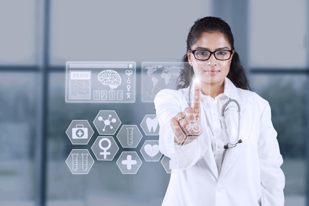 touch screen: Picture of Indian female doctor working in the hospital with a futuristic screen