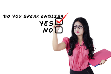 educator: Beautiful young english teacher holding document and writes Do You Speak English