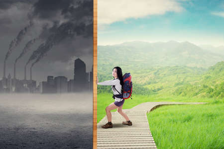 green city: Picture of female hiker carrying a bag and change a polluted city to be a green environment