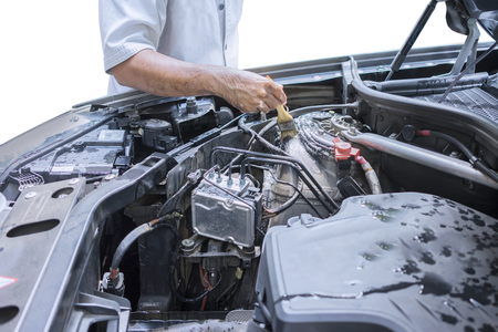 motor car: Image of worker hand cleaning the car machine with a brush to remove dust and dirt Stock Photo