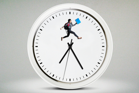 back in an hour: Female high school student carrying bag and jumping on a big clock. Concept of Back to School