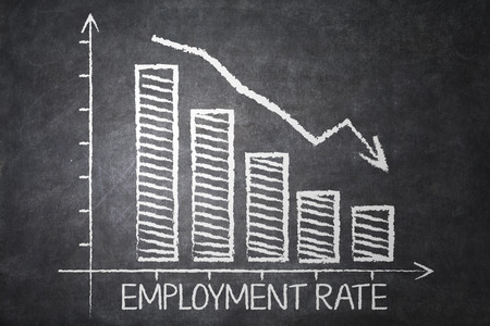 unemployment rate: Chart of declining employment rate with a declining arrow sign on the chalkboard Stock Photo