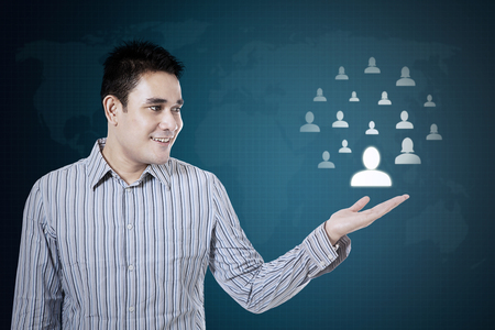 showing: Businessman showing social media network on a virtual background
