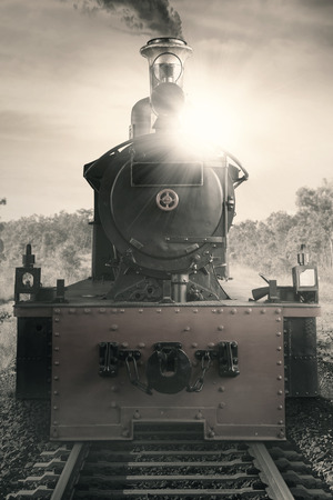 Picture of a steam engine train at the rail, shot with vintage effect