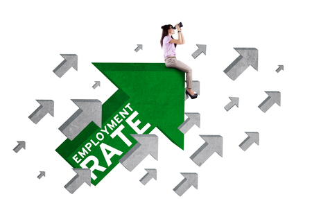 unemployment rate: Photo of female work hunter sitting on the upward arrow sign with employment rate text and using binoculars, isolated on white background