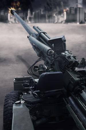 batallón: Imagen de un cañón de tiro militar en la batalla de la ciudad, tiro al aire libre