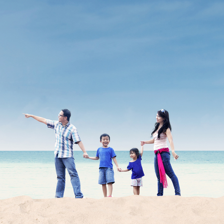 rest day: Asian family enjoying their holiday at white sand beach