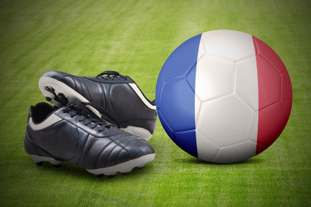 football shoes: Image of two football shoes with a ball and France flag on the meadow. Concept of football championship of Euro 2016 France Stock Photo