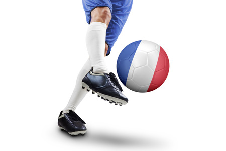 penalty flag: Close up of foot of soccer player kicking a ball with a France flag, isolated on white background.