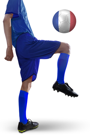 penalty flag: Close up of soccer player wearing uniform playing a ball with a France flag in the studio.