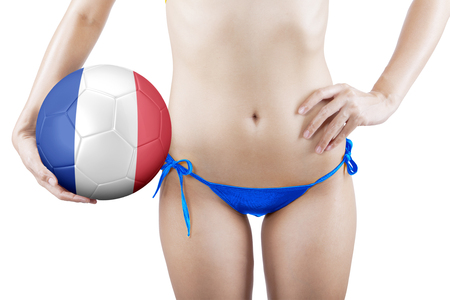 woman underwear: Sexy woman wearing a blue underwear while holding a soccer ball with national flag of France Stock Photo