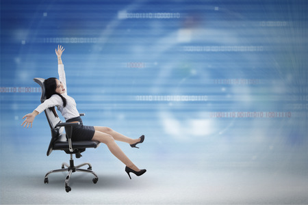 internet connection: Concept of fast internet connection with a young businesswoman driving chair inside cyberspace