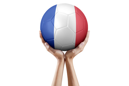 raise the white flag: Close up of hands holding a soccer ball with France flag, isolated on white background.