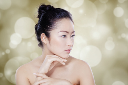 sexy asian woman: Portrait of beautiful Chinese girl with fresh skin after spa treatment against bokeh background Stock Photo