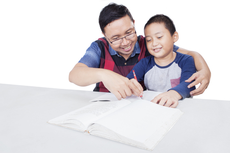 asian boy: Portrait of young father teaching his son to study and doing homework, isolated on white background