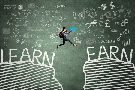 Picture of female high school student jumping on the chalkboard with text of Learn and Earn