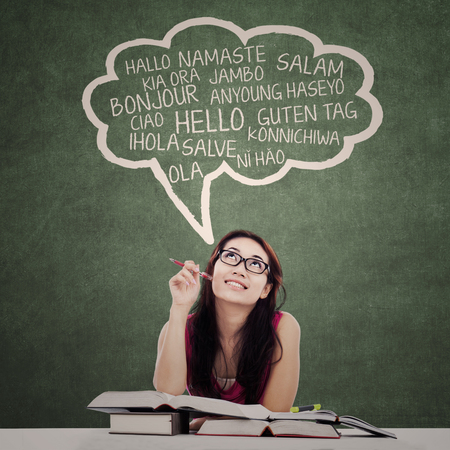 translate: Education concept: female college student learn multi language at class Stock Photo