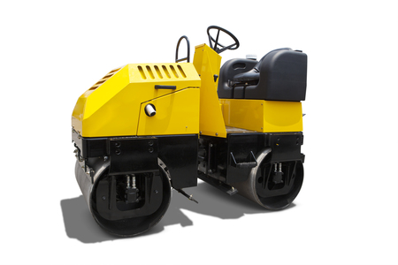 Image of a new asphalt compactor machine with yellow color in the studio, isolated on white background