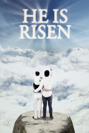 and he shines: Image of happy Christian family standing at the mountain and look at text He is risen on the sky
