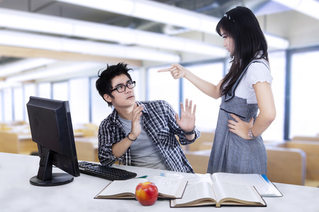 science class: A young female student getting angry with her partner Stock Photo