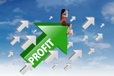 Female entrepreneur sitting on the upward arrow while looking at the sky through binocular with profit word on the arrow Stock Photo