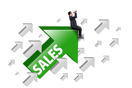 Picture of businessman sitting on the rising arrow with sales word and using binocular, isolated on white background