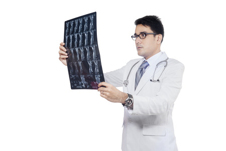 roentgen: Young doctor holding x-ray or roentgen image while checking the results, isolated on white background