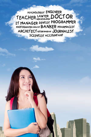 imagines: Picture of a pretty teenage girl imagines her future jobs while looking at cloud speech