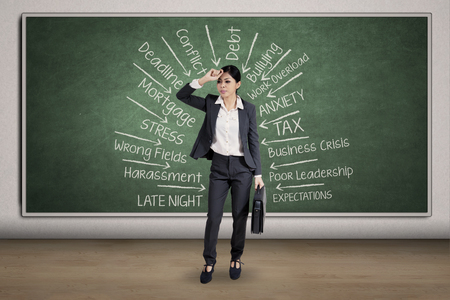 woman business suit: Full length of young businesswoman looks depressed and thinking many problems