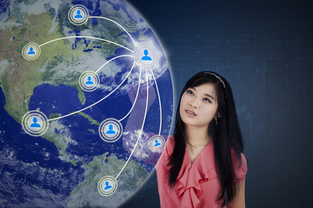 Concept of social media connection with a female worker touching social media button on the virtual screen Stock Photo