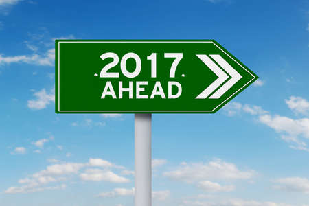 sign road: New year 2017 ahead inside a road sign