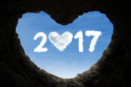 spirits: Silhouette of cave shaped heart and numbers 2017 with heart on the sky